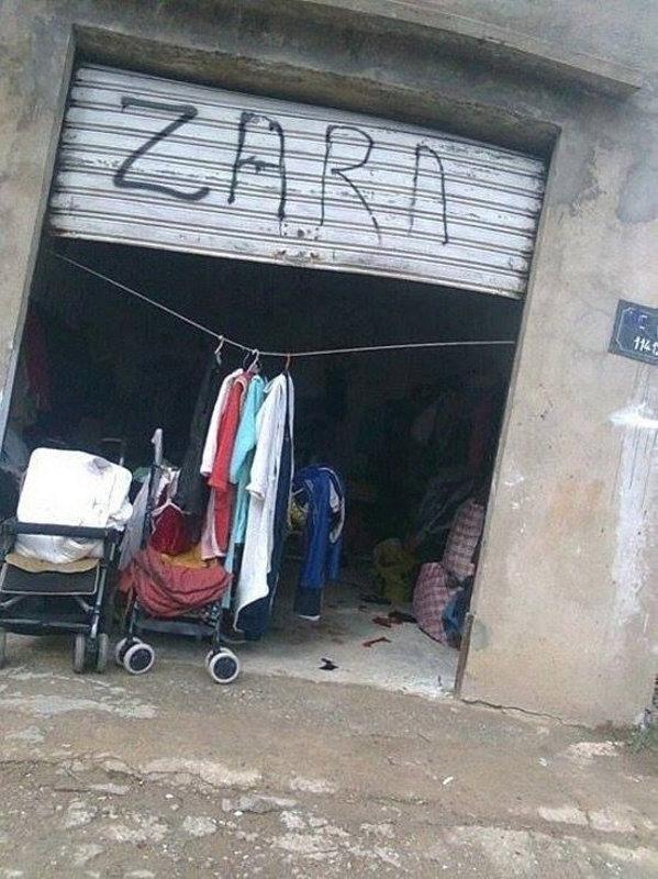 На гараже написано ЗАРА (ZARA)